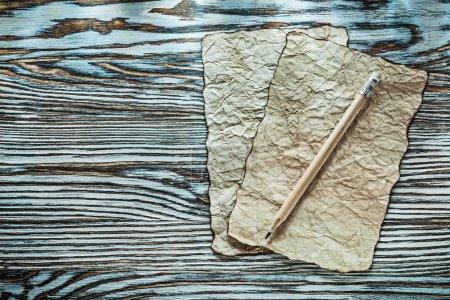 Vintage paper pencil on wooden board