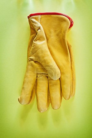 Protective gloves on yellow background.