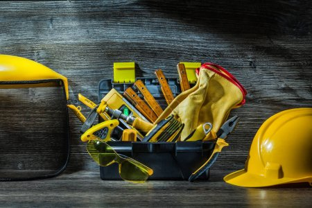 construction tools in little tollbox on table