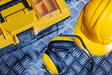 eraphones helmet tool box on corrugated sheet of metal