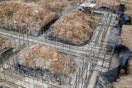 reinforcement of concrete with metal rods connected by wire. Preparation for pouring the Foundation