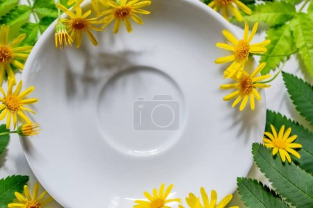 White plate with colorful flowers