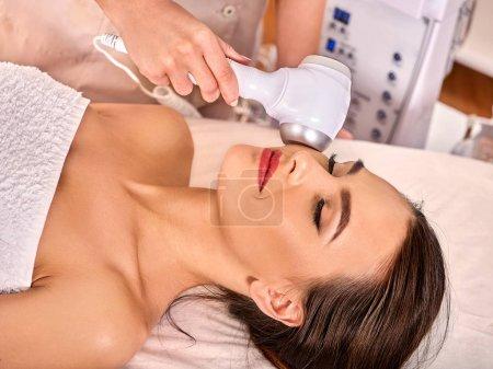 Ultrasonic facial treatment on ultrasound face machine.