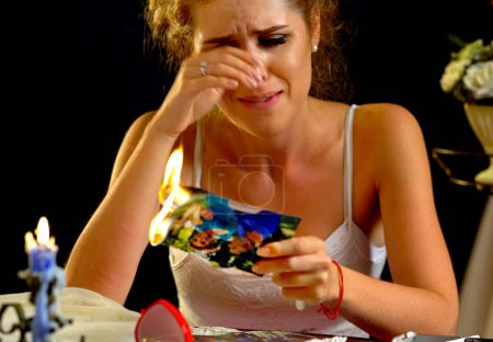 Photo for Wedding memories. Broken heart woman. Couple break up. Sad bride on unhappy wedding. Happiness in relationships is unrealizable. Portrait crying female has divorce. Suffering is especially intense. - Royalty Free Image