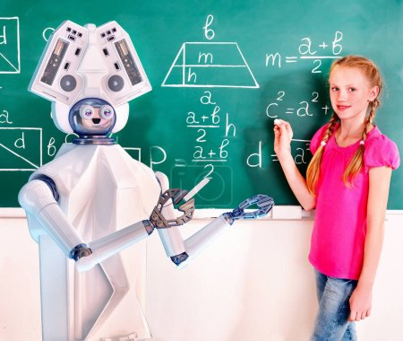School child and ai android robot writting on blackboard in classroom.