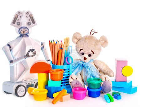 Robot toy and stuffed animals teddy bear and color pencils and cans of paint.