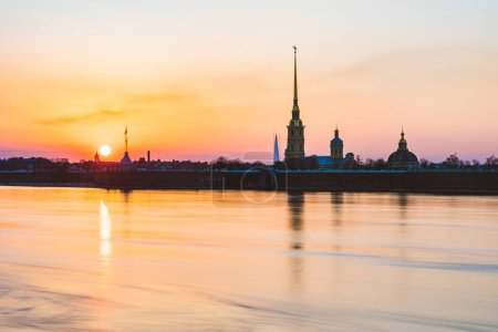 St Petersburg view at sunset with Neva river and Paul and Peter fortress. Long exposure with panoramic view and silhouette at sunset. Architecture and travel.