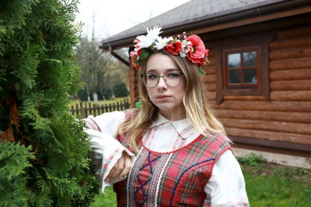 Photo for Serious girl in traditional Belarusian clothes in village - Royalty Free Image