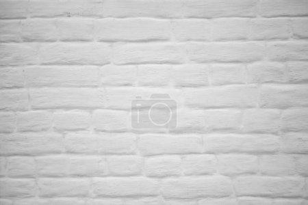 Foto de Ladrillo pintado blanco fondo de pared. Textura de piedra - Imagen libre de derechos