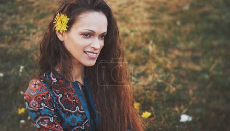 Photo for Happy brunette woman in the summer park. Pretty girl is smiling - Royalty Free Image