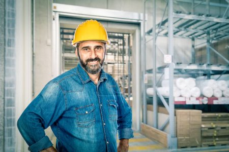 confident handyman wearing yellow helmet