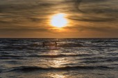 scenic view of sunset by Baltic sea