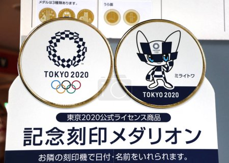 Photo pour Yokohama, Japan - 5 April, 2019: Stand with official logos and mascot Miraitowa of the 2020 Summer Olympic Games in Tokyo - image libre de droit