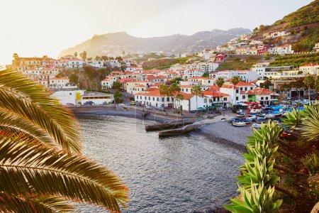 Scenic aerial sunset view of Camara de Lobos village, Madeira, Portugal