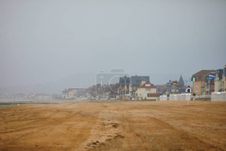 View of Villers-sur-Mer in Lower Normandy, France on a foggy day at low tide