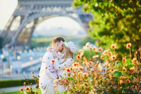 Photo for Romantic loving couple in Paris, near the Eiffel tower - Royalty Free Image