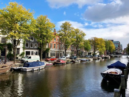 Amsterdam, Netherlands - OCTOBER 01, 2018: Autumn view of Old Amsterdam canal, Holland