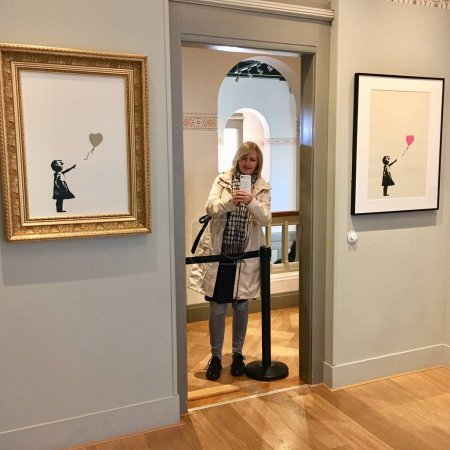 Photo for Amsterdam, Netherlands - OCTOBER 01, 2018: Tourist woman is taking picture by smart phone in Moco Museum, Amsterdam - Royalty Free Image