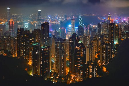 Photo for Famous view of Hong Kong - Hong Kong skyscrapers skyline cityscape view from Victoria Peak illuminated in the evening blue hour. Hong Kong, China - Royalty Free Image