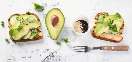 Aavocado toasts. Healthy vegetarian and diet concept. Top view