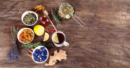 Top view of natural herbal medical remedies on wooden background