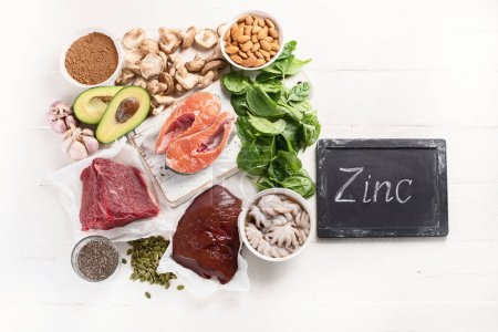 Arrangement food high in Zinc on white tabletop, h...