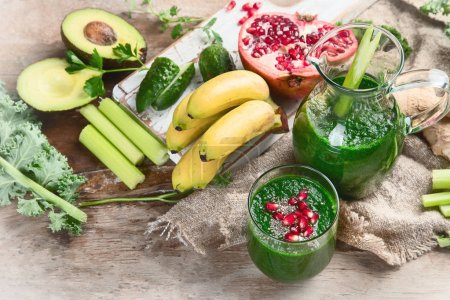 Photo for Flat lay of fresh blended green smoothie vegetables and fruit - Royalty Free Image