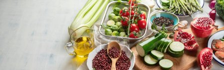 Photo for Panoramic view of Seasonal vegan cooking ingredients on tabletop, healthy food concept - Royalty Free Image