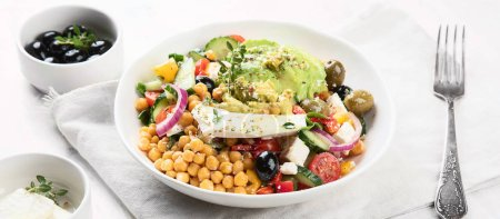 Photo for Panoramic view of Salad with chickpeas, feta and avocado, healthy food concept - Royalty Free Image
