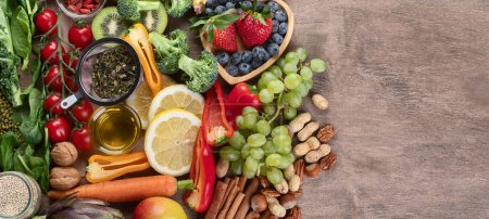 Photo for Natural products rich in antioxidants and vitamins. Healthy clean and detox food - vegetables, fruits, nuts, superfoods. Top view with copy space. . Panorama, banner - Royalty Free Image
