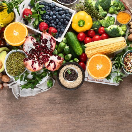 Photo for Healthy diet background. Clean and detox eating. Vegan or gluten free diet. Raw organic fruits, vegetables, grain and superfood  for  cooking. Top view, flat lay with copy spac - Royalty Free Image