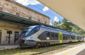 ENNA, ITALY - MAY 9, 2018: Train arrives to Enna railway station (Stazione di Enna), small railway station situated in 5km away well below the Enna old town, Sicily, Italy
