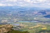 Picturesque green hilly valley near Enna city, central Sicily, Italy. Nicoletti Lake and Leonforte town on the background. View from Castello di Lombardia