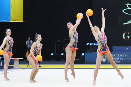 """Photo for KYIV, UKRAINE - MARCH 16, 2019: Team of SLOVENIA performs with 5 Balls during Group Competition of Rhythmic Gymnastics Grand Prix """"Deriugina Cup"""" in Palace of Sports in Kyiv, Ukraine - Royalty Free Image"""