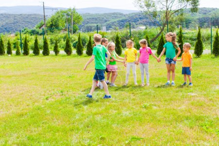 Photo for Active children play together outdoor games during the summer camp - Royalty Free Image