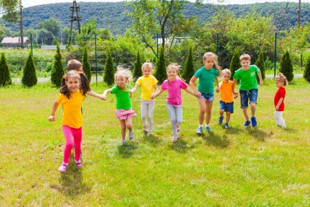Photo for Runnig children having fun at summer camp. Outdoor games for preschoolers - Royalty Free Image