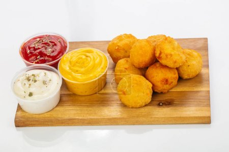 Photo for Tasty Chicken nuggets with sauce - Royalty Free Image