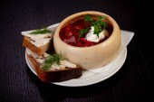 Tasty borsch soup with bread and lard
