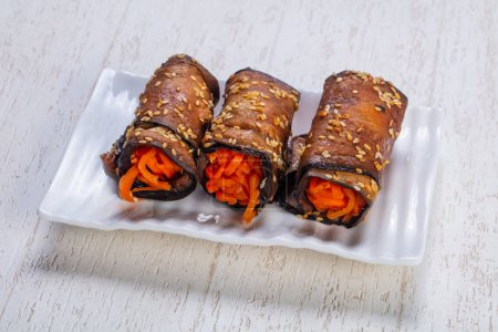 Tasty fried zucchini roll with korean carrot