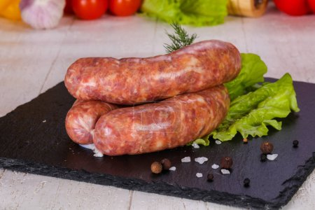 Raw pork sausages ready for grill