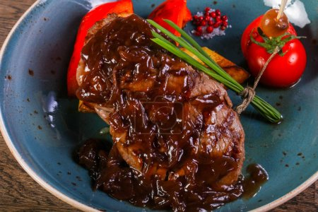 Photo for Beef steak with sauce served vegetables - Royalty Free Image