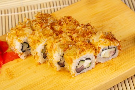 Delicious bonito sushi rolls with ginger
