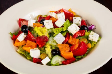 Photo for Greek salad with feta cheese - Royalty Free Image