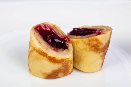 Stuffed pancake with cherry jam