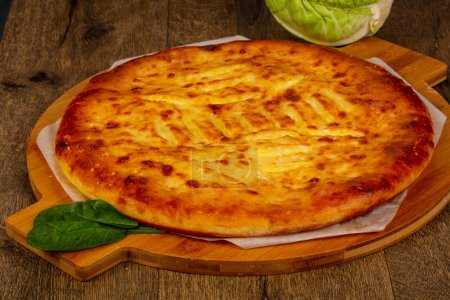 Photo for Homemade traditional tasty Ossetian pie - Royalty Free Image