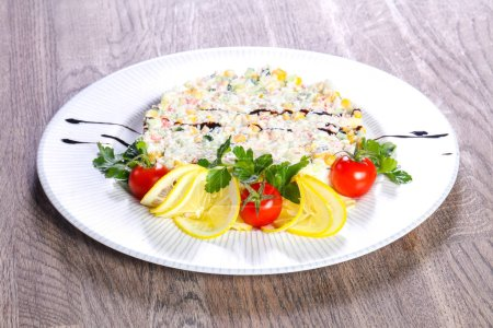 Photo for Salad with crab surimi served lemon and cherry tomato - Royalty Free Image