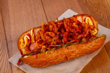 Hot dog with sauce and onion...
