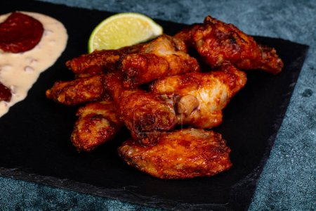 Chicken wings bbq with sauce and lime