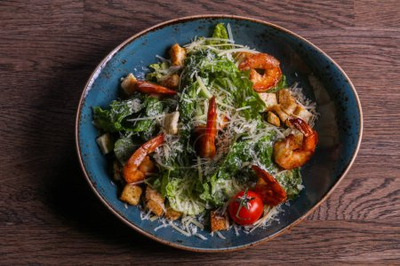 Caesar salad with shrimps and parmesan cheese