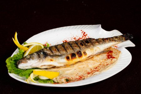 Roasted seabass fish served lemon